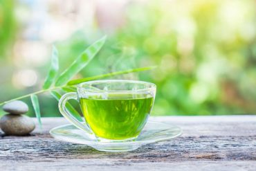 46486245 - cups of green tea on wooden table